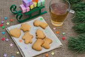 stock photo of flogging  - Christmas theme with floggings sled biscuits and tea - JPG