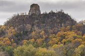 stock photo of winona  - A rock formation on top of a hill during autumn - JPG
