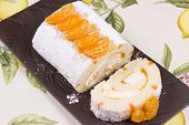 pic of satsuma  - Orange flavoured Swiss roll decorated with orange slices
