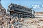 stock photo of earth-mover  - loading a large lorry building material clay pit - JPG