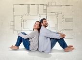 stock photo of blueprints  - Young attractive couple in love happy together thinking and imaging blueprints floor plan and design of new house home flat or apartment in real state concept - JPG