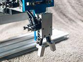 image of plc  - Aluminum pneumatic robot hand grip close - JPG