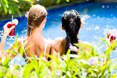 foto of bathing  - Two girls or women in vacation - JPG