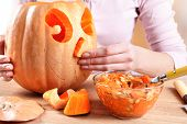 image of hollow  - Hollowing out pumpkin to prepare halloween lantern - JPG