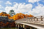 picture of castle  - Osaka Castle in Osaka with autumn leaves Japan landmark of Unesco. ** Note: Visible grain at 100%, best at smaller sizes - JPG