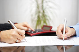 image of divorce-papers  - lawyer and client completing contract and prices - JPG