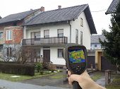 stock photo of leak  - Heat Leak Detection with Infrared Camera - JPG