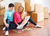 foto of wifes  - Young couple moving in a new home - JPG