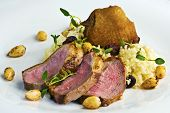 foto of crip  - Grilled duck breast served with raisin couscous with fresh thyme and roasted almonds - JPG