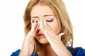 foto of sinuses  - Beautiful young woman with sinus pressure pain - JPG