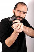 stock photo of gun shot  - Studio shot of a man holding a gun - JPG