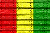 stock photo of guinea  - flag of Guinea painted on brick wall - JPG
