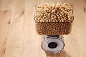 stock photo of soy bean  - weighing the amount of soy beans - JPG