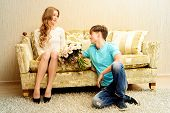 stock photo of sweetheart  - Young man giving flowers to his sweetheart - JPG