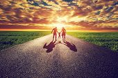 picture of father child  - Family walk on long straight road - JPG