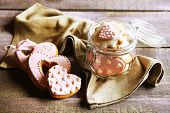 foto of glass heart  - Heart shaped cookies for valentines day in glass jar on  wooden background - JPG