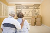 pic of shelving unit  - Hugging Senior Couple In Empty Room with Shelf Design Drawing on Wall - JPG
