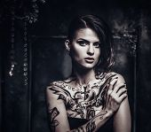 stock photo of spooky  - Tattooed beautiful woman in old spooky interior - JPG