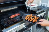 pic of grilled sausage  - BBQ with sausages and red meat on the grill  - JPG
