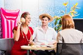stock photo of shells  - Woman in travel agency shell to shell - JPG