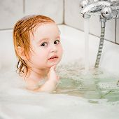 foto of 15 year old  - cute two year old baby bathes in a bath with foam closeup - JPG