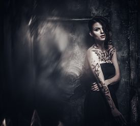 picture of gothic girl  - Tattooed beautiful woman in old spooky interior - JPG