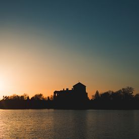 stock photo of tatas  - Sunset over Old lake - JPG