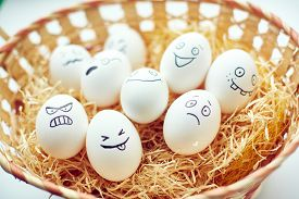 picture of emotion  - Basket with funny eggs with painted faces expressing different emotions - JPG