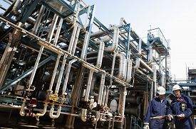 picture of refinery  - oil workers and the main refinery fuel station supplying shipping industry - JPG