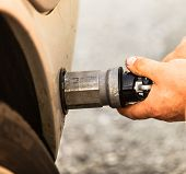 stock photo of fuel economy  - Auto refuel. Car at gas station being filled with fuel fill up of liquefied petroleum gas LPG ** Note: Shallow depth of field - JPG