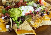 foto of nachos  - Homemade Nachos with tortilla chips cheese and guacamole - JPG