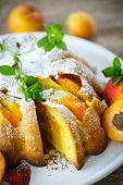 stock photo of sponge-cake  - Sponge cake with apricot and powdered sugar