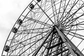 pic of ferris-wheel  - Stationary ferris wheel with s set against a white sky - JPG