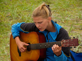 foto of musical instrument string  - hiker girl playing guitar camping hiking musical instrument - JPG