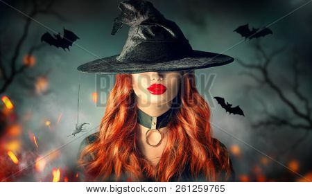 poster of Halloween Sexy Witch girl portrait. Beautiful young woman in witches hat with long curly red hair an