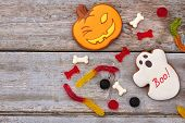 Halloween Sweets On Wooden Background. Halloween Cookies And Jelly Candies, Copy Space. Happy Hallow poster