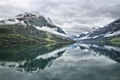 Serene Dramatic Landscape In Norway - Cloudy Nordfjord View In Olden. poster