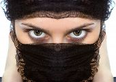 Arabian woman close-ups green eye look on white background