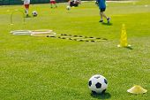 Physical Education Class. Soccer Training Session On The Grass Sports Field. Football Training Equip poster