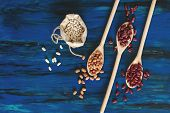 Assortment Of Kidney Beans In Wooden Spoon On Dark Blue Wooden Background, Mung Bean, Red Kidney Bea poster