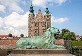 Lion Bronze Sculpture Guards The Entrance Of Rosenborg Castle, Built In 17th Century. Historical Lan poster