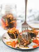 Salad Of Pickled Eggplant, Carrot, Onion, Sweet Pepper On Plate Over Gray Cement Background.fork In  poster