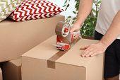 Man Packing Carton Box Indoors, Closeup. Moving Day poster