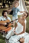 Sweet Family Of Hippies Having Fun Together poster