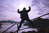 Man With Raised Arms On Top Of A Surreal Mountain, Concept Of Inspiration, Enthusiasm And Aspiration poster