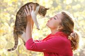 young attractive girl with cat on natural background