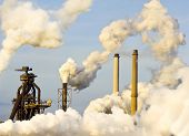 stock photo of blast-furnace  - The top of a blast furnace and several smoke stacks - JPG