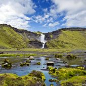 The Ofaerufoss waterfall in the Eldgja volcanic canyon of Iceland's Landmannalaugar national park wi
