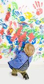 picture of finger-painting  - Young boy busy finger painting - JPG
