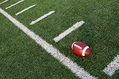 pic of ncaa  - American football near the hashmarks - JPG
